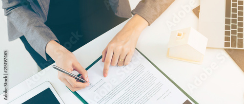 Client Signs Document to Buy House and Real Estate Canvas Print