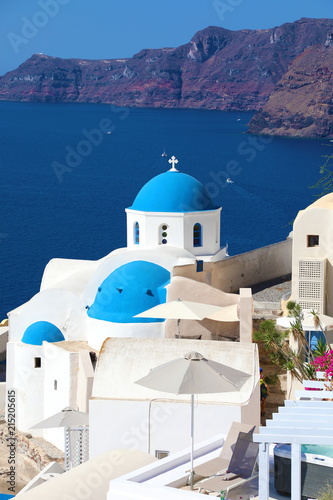 Santorini: Oia traditional greek white village with blue domes of churches, Greece