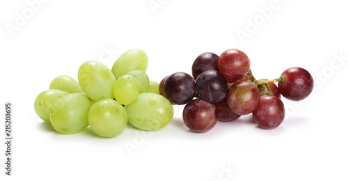 Vászonkép  Dark and white grapes isolated on white background