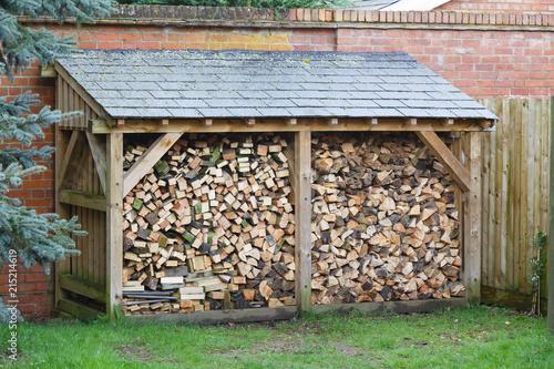 Vászonkép Log store with firewood