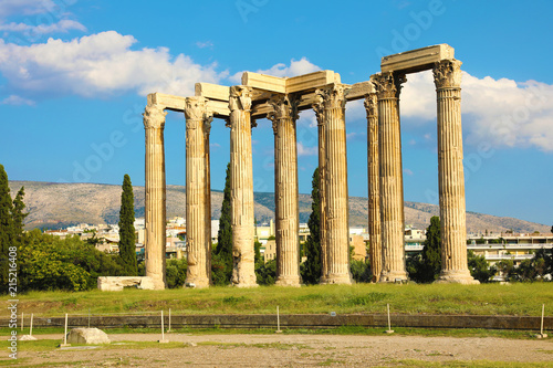 Fotobehang Bedehuis The Temple of Olympian Zeus or the Olympieion is a monument of Greece and a former colossal temple in the centre of the Greek capital city Athens.