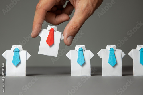 Fototapeta Choosing good employee leader. Man chooses and takes in the hand an employee in shirt and red tie. recruitment obraz