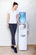 Woman, 20s, caucasian, standing at water cooler wearing sportwear