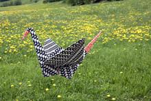 Origami Crane Flying Over Meadow