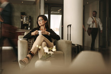 Businesswoman Waiting At Airport Lounge