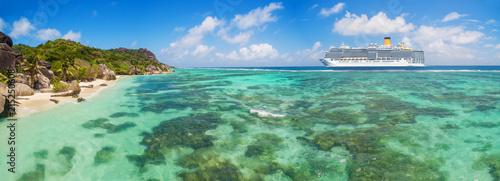 Luxury cruise boat with tropical Seychelles island