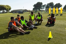 Players Relaxing On Sports Field