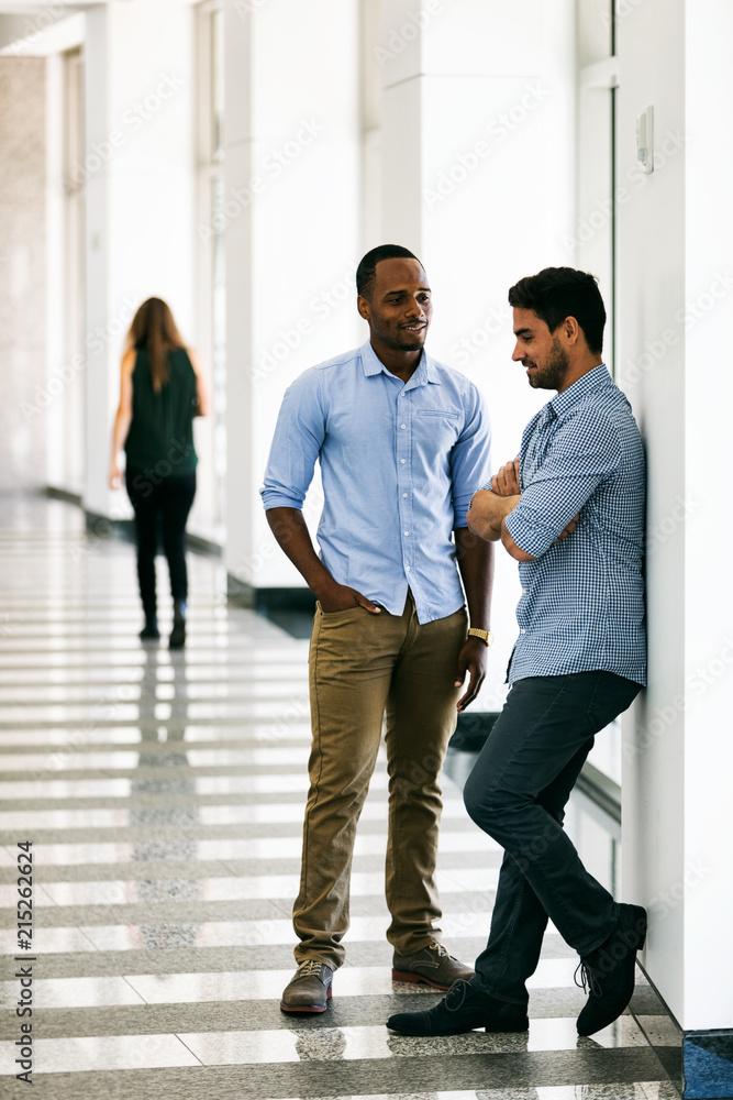 Fototapeta Workspace: Work Friends Having Discussion In Hallway