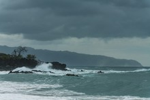 Waves Of Sea Crashing At Rocky...