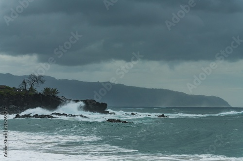Waves of sea crashing at rocky coastline