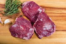 Raw Beef Cheeks On Chopping Bo...