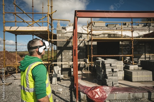 Engineer with VR headset looking at the construction site