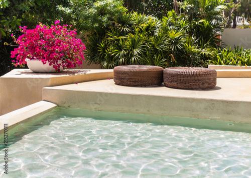 Cadres-photo bureau Jardin Sunbathing lounger swimming pool side./ Sunbathing lounger swimming pool side and flower pot decoration on summer.