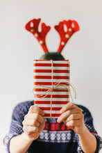 Woman Holding A Christmas Pres...