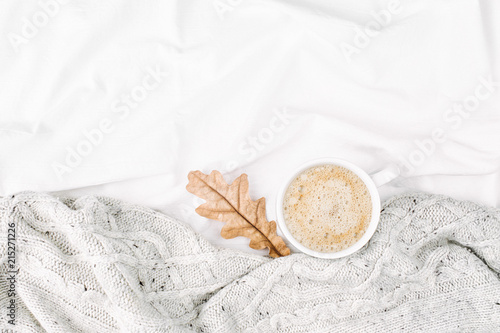 Cup of coffee on bed with warm plaid Wallpaper Mural