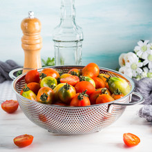 Italian Tomatoes In A Colander On Table. Cooking With Tomatoes Concept. Local Organic Vegetables
