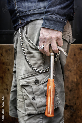 Carpenter carrying hammer and nails