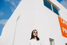 Young Stylish Woman In Sunlight
