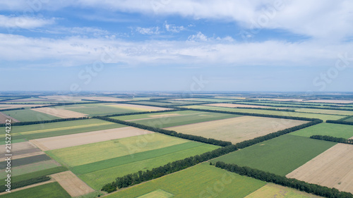 Vue aerienne Aerial view of fields with various types of agriculture, against cloudy sky
