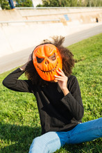 Girl Wearing Halloween Mask On...