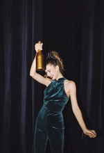 Woman Clubber Dancing With Wine Bottle