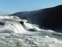 View Of Cascades Of White, Foamy Water Rushing Down In Gullfoss Waterfall