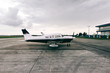 Small Private Airplane Standing on Airfield