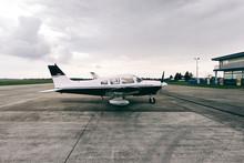Small Private Airplane Standin...