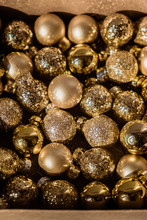 Close Up Of Small Golden Christmas Balls