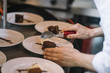 Chef prepares sweet desserts with chocolate.