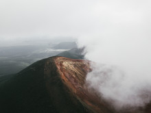 Aerial Shot Of Epic Volcanoes In Kamchatka Trough Clouds