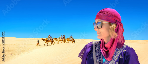 Close-up portrait of young woman in arabic traditional clothing. Sahara desert. Tunisia, North Africa