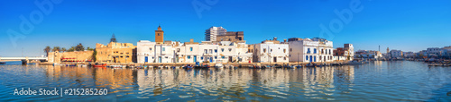 Photo Stands Tunisia Waterfront panorama with picturesque houses and wall of kasbah at old port in Bizerte. Tunisia