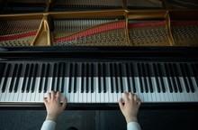 Schoolgirl Playing Piano In Mu...