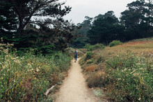 Woman On A Trail On A Nature Walk