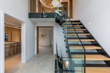 Entrance Hall Of A Modern House With Views Of Staircase, Kitchen And Hall.