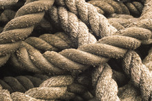 Close-up Of Rope Used For A Tug Boat Towline, Coiled On Deck, USA