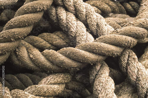 Aluminium Prints Textures Close-up of rope used for a tug boat towline, coiled on deck, USA