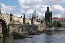 Charles Bridge Crossing The Vltava River With The Old Town Bridge Tower And Church Of St Francis Seraphinus, Prague, Czech Republic.
