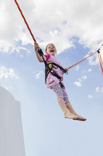 6 Year Old Girl Jumping With A...