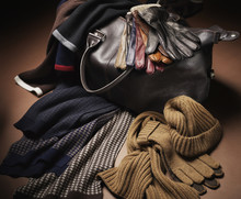 Various Men's Winter Accessoires And Leather Bag On Brown Background