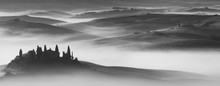 Silhouette Of Podere Belvedere With Mist At Sunrise At San Quirico D'Orcia In Val D'Orcia In Tuscany, Italy, In Black And White