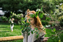 Sukkot: Girl Carries Branch To Use As Sukkah Covering