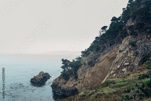 Foto op Canvas Kust Rocky cliff by the ocean