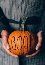 Man Holding Halloween Pumpkin