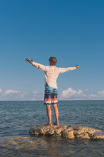 Portrait Of Young Man Admiring The Beautiful Seascape