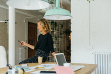 Mature Businesswoman Working A...