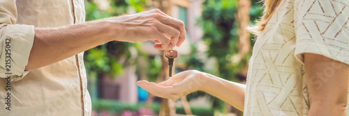 Fotografiet Real estate agent giving keys to apartment owner, buying selling property business