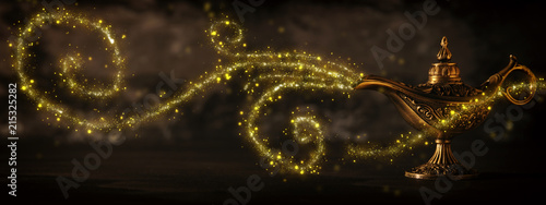 Photographie  Image of magical mysterious aladdin lamp with glitter sparkle smoke over black background
