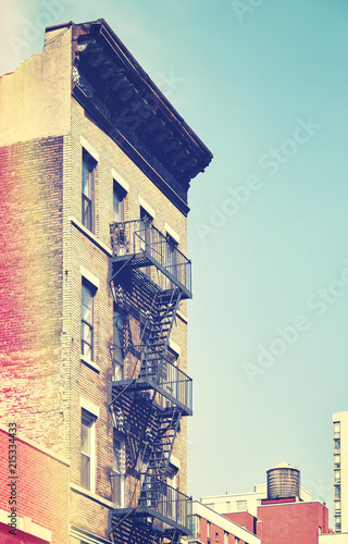 Poster New York City Retro toned picture of an od building with fire escape ladders, New York City, USA.